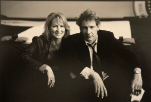 Gail Katz在《空军一号》拍摄期间与Harrison Ford的合影